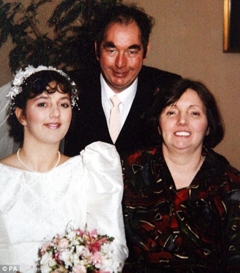 Julie Harrison with her parents Reg and Betty on her wedding day in 1992