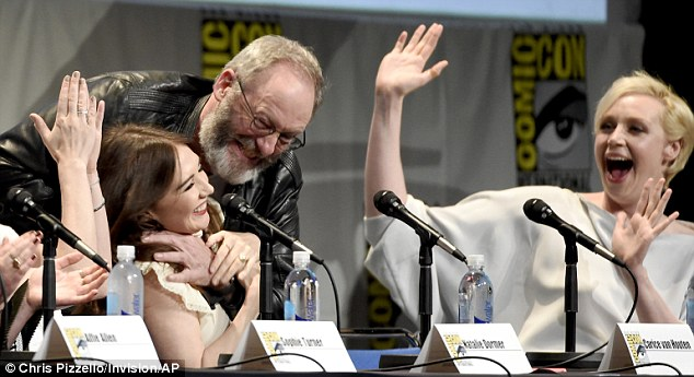 This is forPrincess Shireen: Liam Cunningham hammed it up by pretending to throttle Carice van Houten