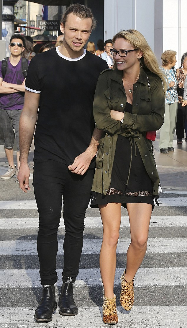 Sparking romance rumours: 5 Seconds Of Summer's Ashton Irwin had the look of love on Wednesday as he cosied up to rumoured girlfriend Bryana Holly during a shopping trip in Los Angeles, California