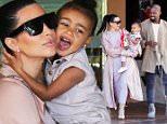 Kim Kardashian and Kanye West take baby North to the cinema to see Minions.\n\nPictured: Kim Kardashian and Kanye West and baby North\nRef: SPL1076095  120715  \nPicture by: Clint Brewer / Splash News\n\nSplash News and Pictures\nLos Angeles: 310-821-2666\nNew York: 212-619-2666\nLondon: 870-934-2666\nphotodesk@splashnews.com\n