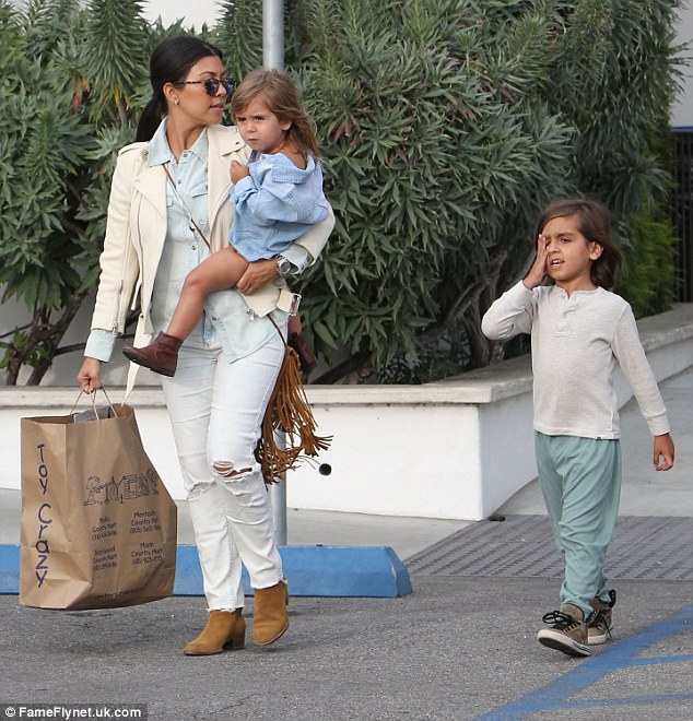 Single mother: Kourtney shares son Mason, five, daughter Penelope, three, and six-month-old baby boy Reign, not seen in this photo, with Scott who hasn't been home for a month