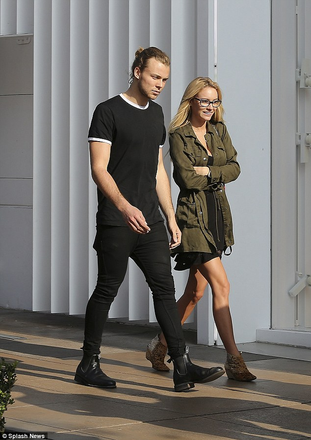 In sync: Swaying towards her to lock his shoulder into hers, Ashton seemed to whisper something in Bryana's ear as she fell into a fit of giggles