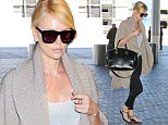 Charlize Theron heading to London after her split from Sean Penn looking gorgeous .  Sunday, July 12, 2015. X17online.com