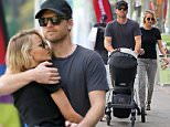 UK CLIENTS MUST CREDIT: AKM-GSI ONLY\nEXCLUSIVE: Vancouver, Canada - 'Avatar' star Sam Worthington and his beautiful wife Lara Bingle were spotted bringing their three-month old baby Rocket to sushi take-out in Vancouver on Thursday afternoon. The happy couple couldn't keep their hands off each other, staying close as Sam wrapped his arms protectively around Lara. Once the actor spotted our shutterbugs, he offered up a playful one-fingered salute behind Lara's back.\n\nPictured: Sam Worthington and Lara Bingle\nRef: SPL1077268  120715   EXCLUSIVE\nPicture by: AKM-GSI / Splash News\n\n