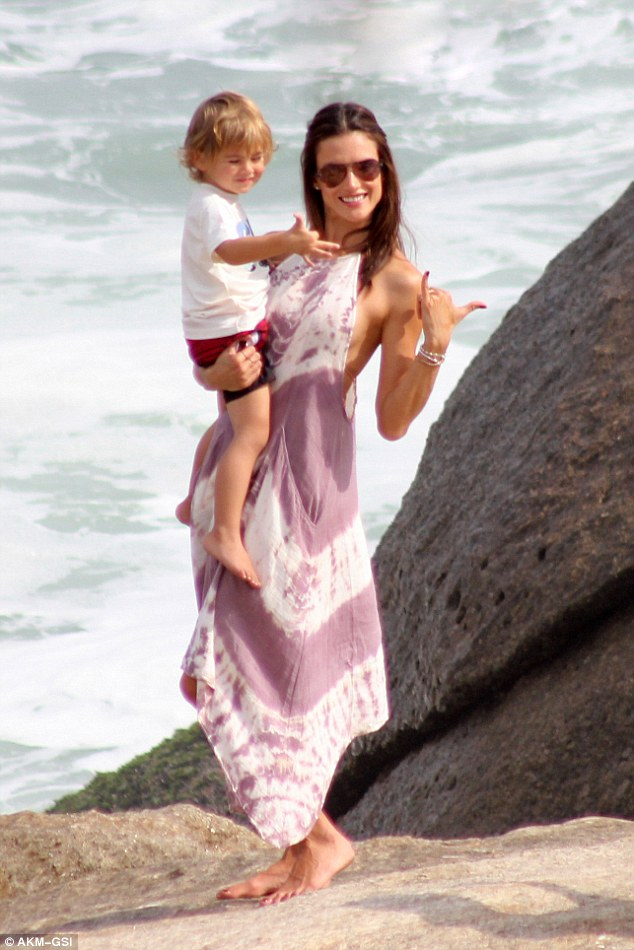 Just the two of us: Alessandra covered up in a light tie-dye kaftan when she wasn't in the sea