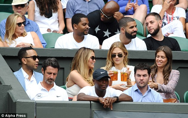 Come on Serena! The American's player's box was packed with stars earlier this week when supermodel Karlie Kloss (second row, second right) joined Chrissy Teigen and John Legend (second and third left) and rapper Drake (third row, second right)