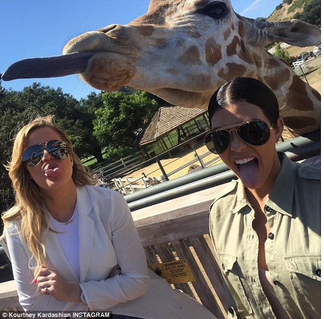 'We found Henry': Kourtney posted this very similar snap referencing a blowup giraffe her sister once owned