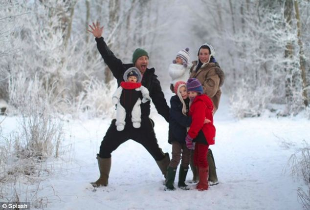 Pictured: Jamie Oliver and family pose in the snow