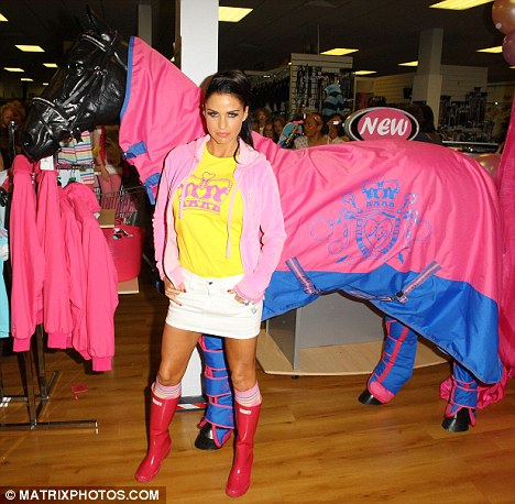 Enough pink for you? Price shows off a KP Equestrian pink stable rug on a model horse