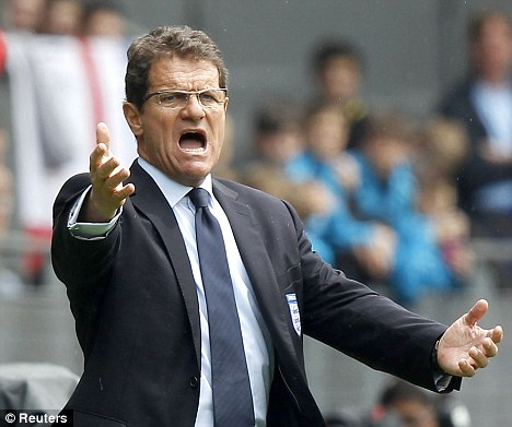 Staying: Fabio Capello penned a new deal as England jetted off