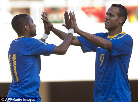 Luis Fabiano (right) celebrates with Brazil goalscorer Robinho