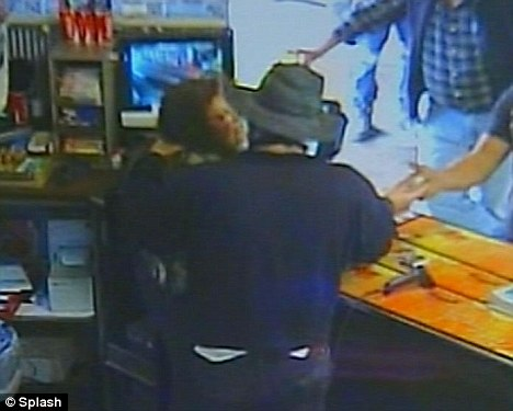 The shop worker retaliates and knees the man in the groin