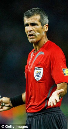 Referee Horacio Elizondo gestures during the FIFA World Cup Germany 2006 Final match between Italy and France in Berlin