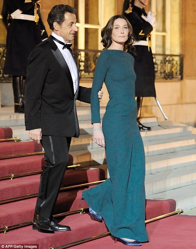 Glamour couple: Despite braving the steps of the palace without a bra, Carla Bruni and husband Nicolas Sarkozy looked every inch the dazzling couple