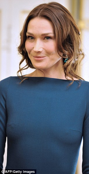 Chic and sheer: Carla Bruni appears apparently braless on the steps of the Elysee Palace in Paris