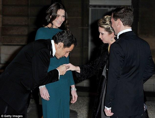 Chivalry is not dead: Nicolas Sarkozy kisses Svetlana Medvedeva's hand  while Carla Bruni and Dmitry Medvedev look on