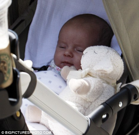 Catching some Zzzzz: Baby Betsy sleeps peacefully in her pram