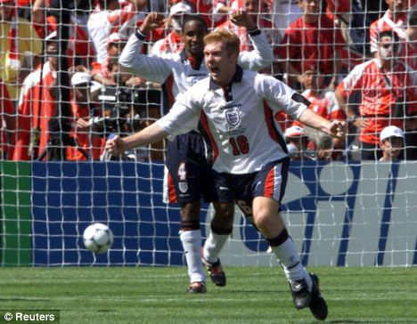 Now and then: Paul Scholes celebrates after scoring against Tunisia at the 1998 World Cup (above) and after yet another goal for Manchester United (below)