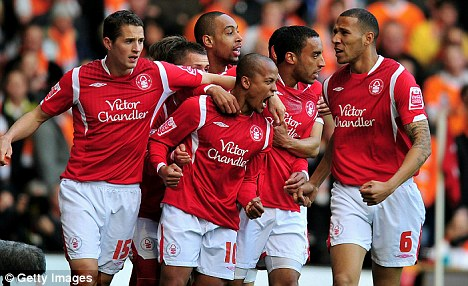 Roaring on: Forest players celebrate with Earnshaw after his opener
