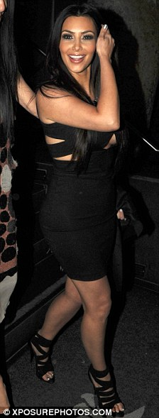 Peek-a-boo: Kim Kardashian wore a revealing little black dress as she dined at Katsuya in Hollywood last night