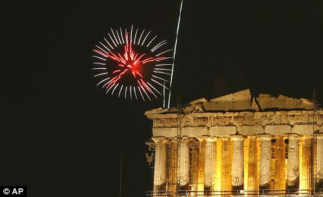Fireworks illuminate the ancient Parthenon