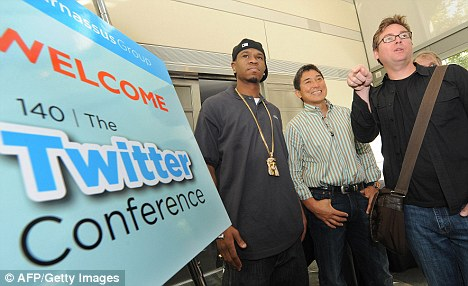 Twitter co-founder Biz Stone, right, said promoted tweets which fail to resonate with users would 'disappear'