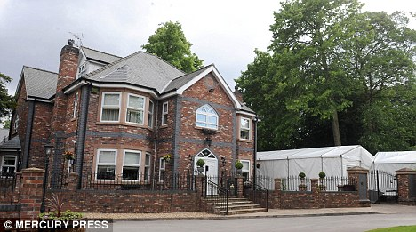 General view of the family home of Coleen Rooney (Mrs Wayne Rooney), in Huyton Liverpool, which has a huge marquee erected around the house for a family party ahead of England's World Cup clash