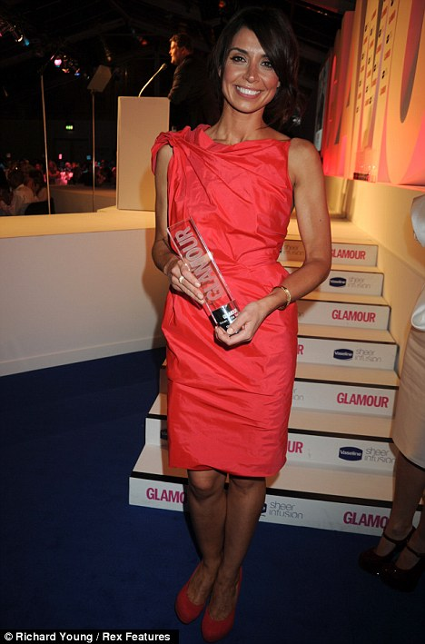 Accolade: Christine clutches her Glamour award for Presenter of the Year 2010