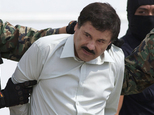 "FILE - In this Feb. 22, 2014, file photo, Joaquin ""El Chapo"" Guzman, head of Mexico¿s Sinaloa Cartel, is escorted to a helicopter in Mexico City, following his capture overnight in the beach resort town of Mazatlan. Mexico¿s security commission said in a statement late Saturday, July 11, 2015, the top drug lord Joaquin ¿El Chapo¿ Guzman has escaped from a maximum security prison, the second time he has fled after being captured. (AP Photo/Eduardo Verdugo, File)"