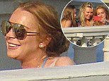 Picture Shows: Lindsay Lohan  July 11, 2015    Actress Lindsay Lohan and some friends enjoy a day on a balcony in Monaco. The three friends took selfies and put on makeup.    Exclusive All Rounder  UK RIGHTS ONLY  FameFlynet UK � 2015  Tel : +44 (0)20 3551 5049  Email : info@fameflynet.uk.com
