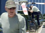 Picture Shows: Harrison Ford  July 12, 2015    'Star Wars' actor Harrison Ford stops to double check his helicopter before taking flight at the Santa Monica Airport in Santa Monica, California.     Harrison is back to his old self after his plane crash in March and made his first public appearance since the crash on Friday at San Diego's Comic-Con. He delighted fans with a surprise visit to the 'Star Wars: The Force Awakens' panel.    Exclusive All Rounder  UK RIGHTS ONLY  FameFlynet UK � 2015  Tel : +44 (0)20 3551 5049  Email : info@fameflynet.uk.com