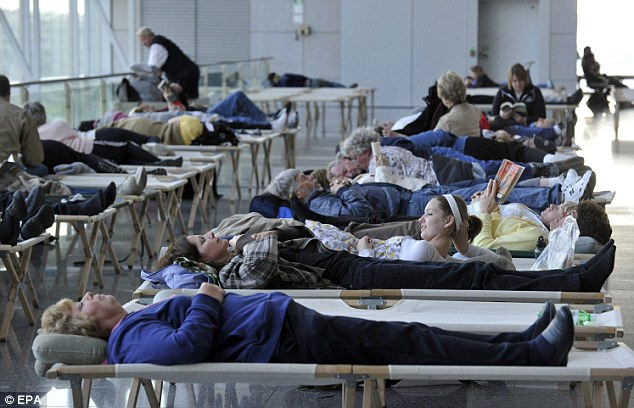 Going nowhere: Stranded passengers on temporary beds at Frankfurt International Airport in Germany