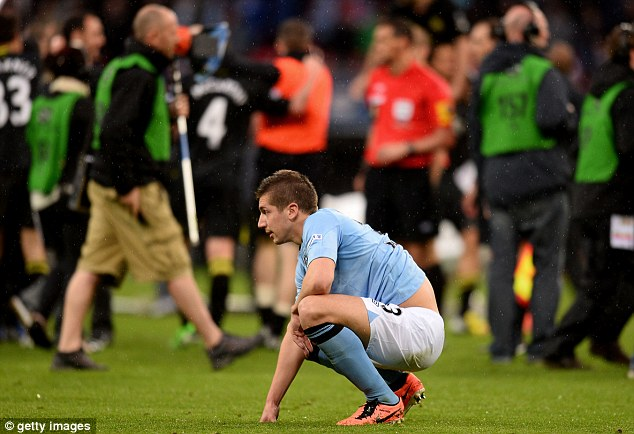 Gutted: City defender Matija Nastasic looks dejected after the defeat