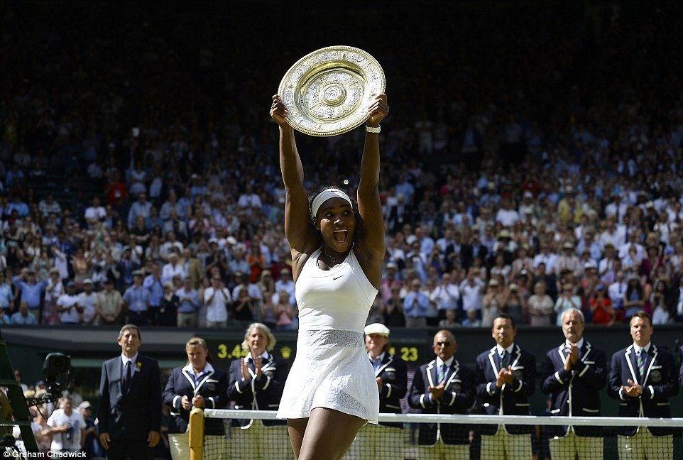Delight: The 33-year-old celebrates in front of the crowd. She is now just one step away from holding all four of the world's major titles at the same time