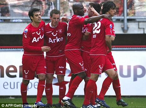 Closing in: Twente must match Ajax's result on Sunday to get their hands on the Eredivisie title