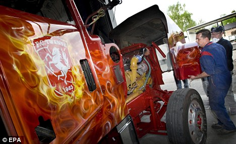 All aboard the party bus: This truck hopes to be the centre piece of Twente's title celebrations