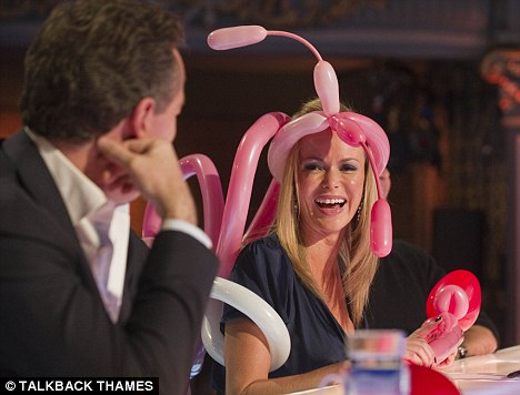 Fairy good: Amanda beams as she realises she's been dressed up with a tiara, wings and a wand by the talented double act
