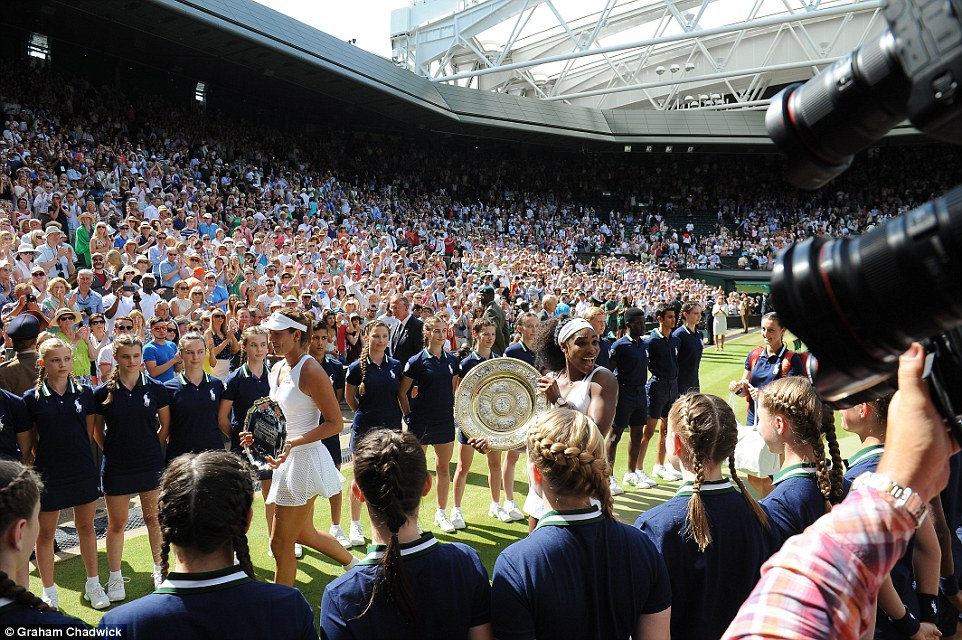 Celebration: Serena Williams and Garbine Muguruza leave Centre Court clutching their trophies, after Serena's decisive victory