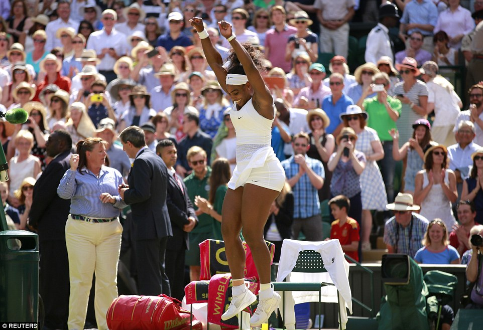 Winning moment: The crowd celebrates alongside Williams as she clinches her sixth victory at the All England Club