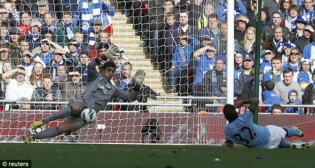 Vital stop: Wigan goalkeeper Joel Robles denied Carlos Tevez from opening the scoring in the first half