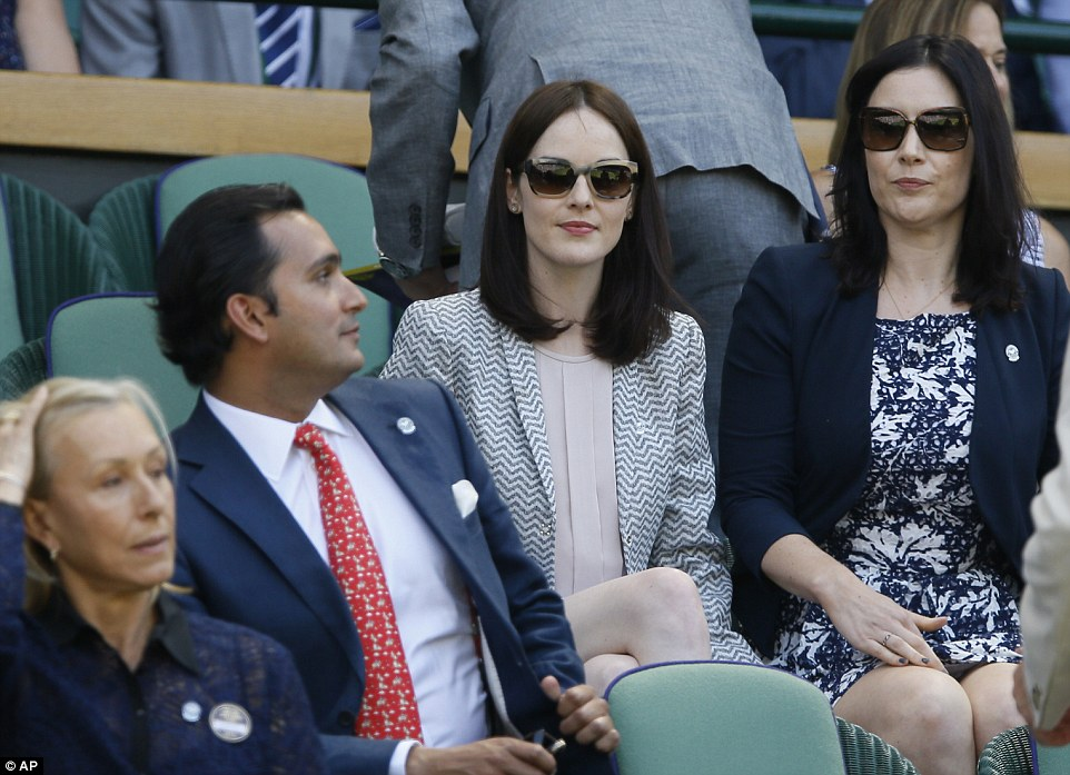 Elegant: Michelle Dockery was joined in the Royal Box by a friend as she took her seat ahead of this afternoon's Ladies Final