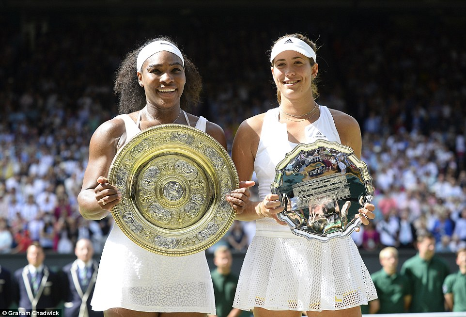 Competitors: Serena and 21-year-old Spaniard Muguruza stand side-by-side with their trophies. The Spaniard was so overcome with emotion after losing her first Wimbledon final she cried into her towel at the side of the court