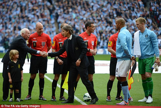 Greetings: Mancini shakes hands with Whelan before the match