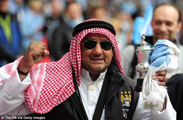In the spirit: A Manchester City fan enjoys himself before the match