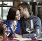 Man and woman sitting in restaurant and drinking wine --- Image by © Katarina Premfors/arabianEye/Corbis