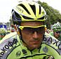 Tinkoff-Saxo rider  Ivan Basso (L) rides next to Team Sky rider Chris Froome of Britain, race leader's yellow jersey, at the start of the 223.5-km (138.9 miles) 4th stage of the 102nd Tour de France cycling race from Seraing in Belgium, to Cambrai, France, July 7, 2015. Former Giro d'Italia winner Ivan Basso withdrew from the Tour de France on Monday July 13, 2015 after revealing he has testicular cancer. Picture taken July 7, 2015.   REUTERS/stefano Rellandini
