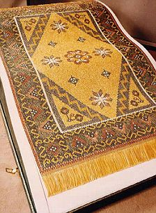 A carpet made from solid gold threads and 25,000 precious stoned, completed in 1993 and bought by Prince Jefri.