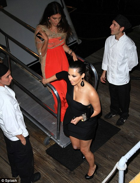 Mind the deck: Kim's stiletto heels are unsuitable for her trip to sea