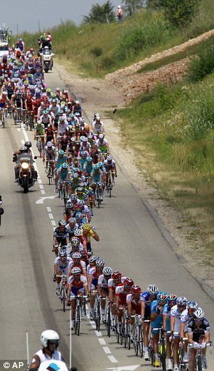 Line up: The pack rides downhill during the seventh stage