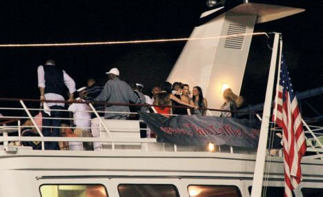 Party time: The yacht trip was Kim's third in a week